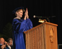 Chancellor Koch applauds graduates at the 2012 UIS Commencement Ceremony.